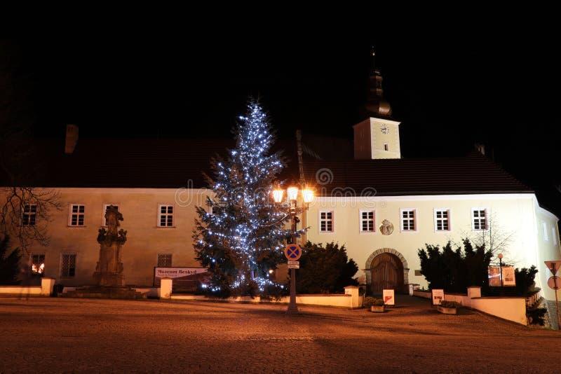 A beautiful christmas trees on Frydek square in Frydek Mistek in Czech republic. Christmas tree near Frydek lock in the dark.  royalty free stock photo