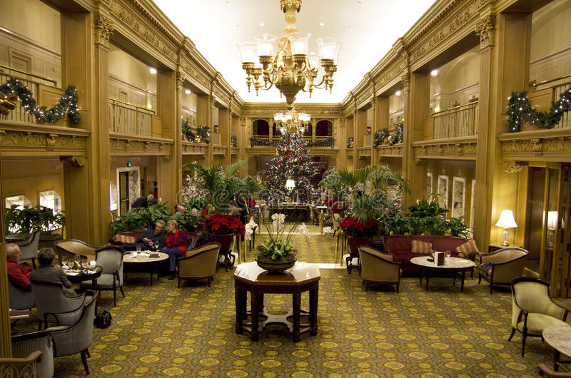 Beautiful Christmas trees in a luxury hotel royalty free stock photos