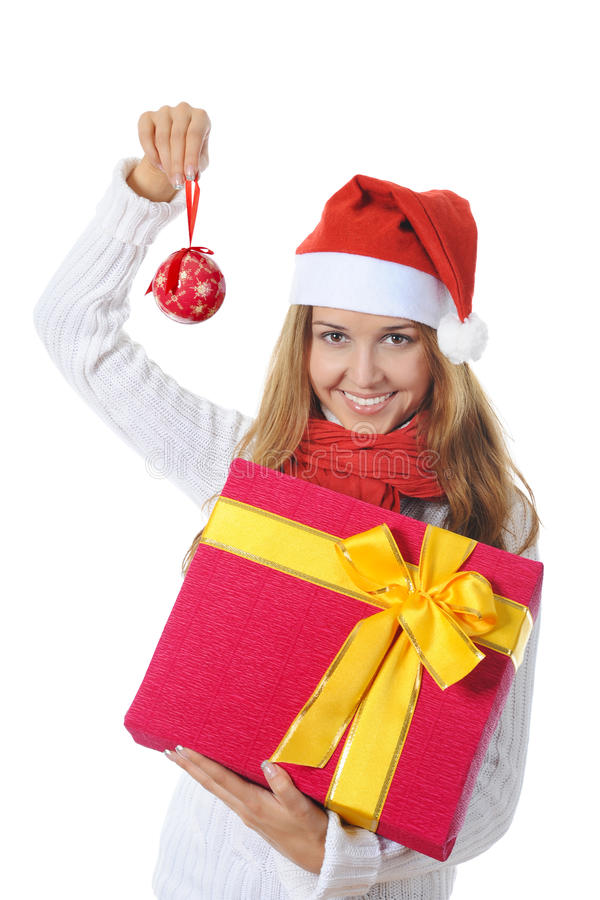 Beautiful christmas woman with a gift stock image