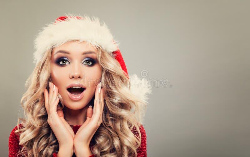 Beautiful Christmas Woman wearing Santa Claus Hat royalty free stock photo