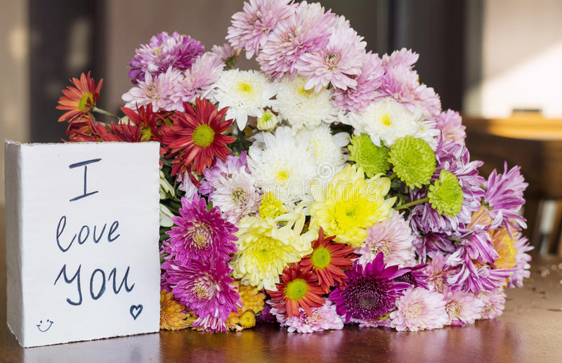 beautiful chrysanthemums bouquet with i love you card