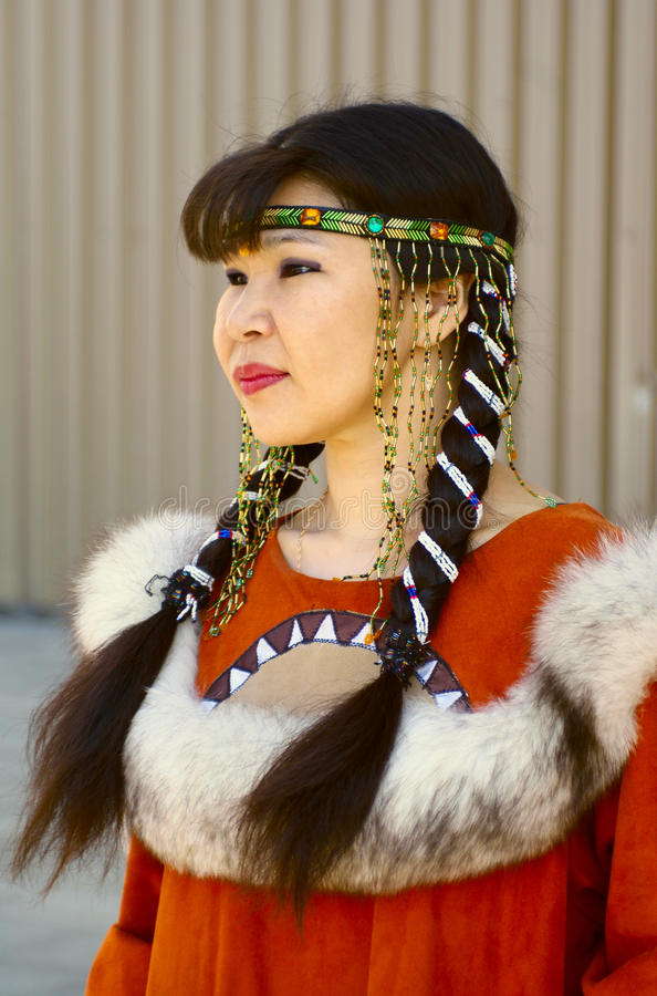 Beautiful chukchi woman. In folk dress stock photography