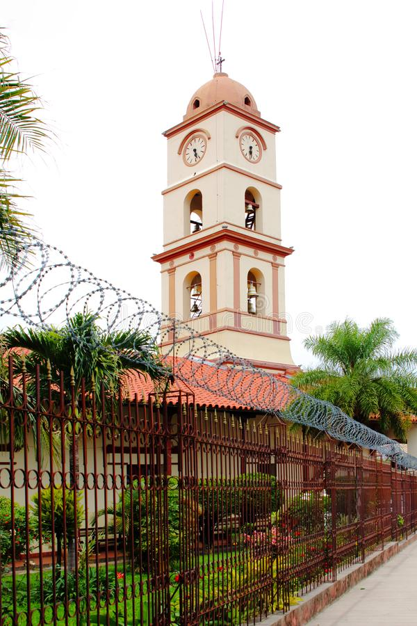 Beautiful church in Santa Cruz de la Sierra city center, Bolivia. With blooming flowers stock photo