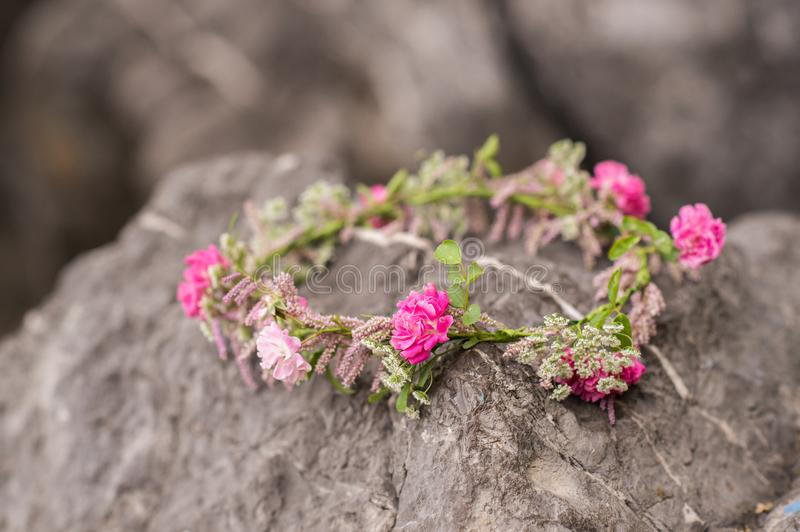 Beautiful circlet of flowers. Beautiful pink roses and different flowers stock photo