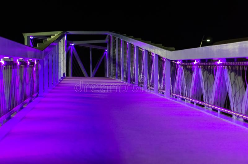 Beautiful city bridge with purple and blue lights modern city architecture in scheveningen the netherlands urban city scenery stock photos