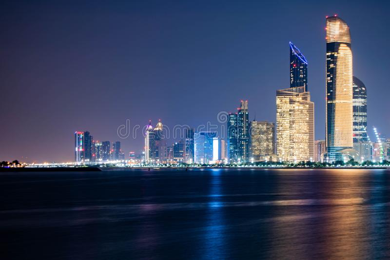 Beautiful City night view of Abu Dhabi financial and commercial district, taken during blue hour, view from marina backwater, stock photos