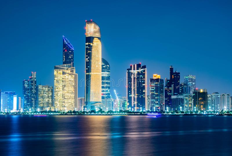 Beautiful City night view of Abu Dhabi financial and commercial district, taken during blue hour, view from marina backwater, royalty free stock photography