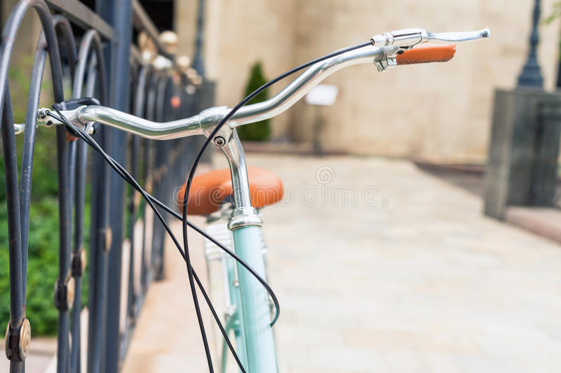 Beautiful city vintage bicycle for travel at europe. At summer time. Selective Focus at bicycle at foreground stock image