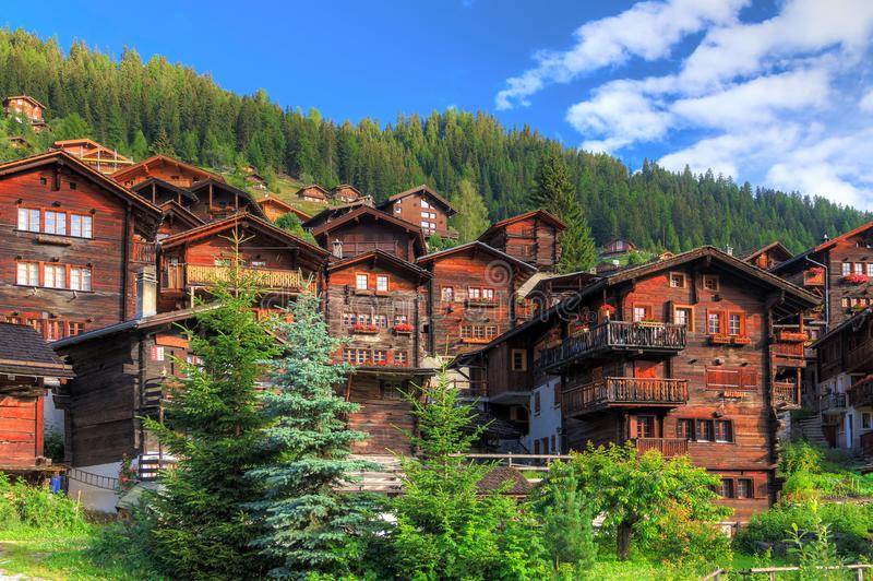 Traditional houses in the swiss alps royalty free stock photography