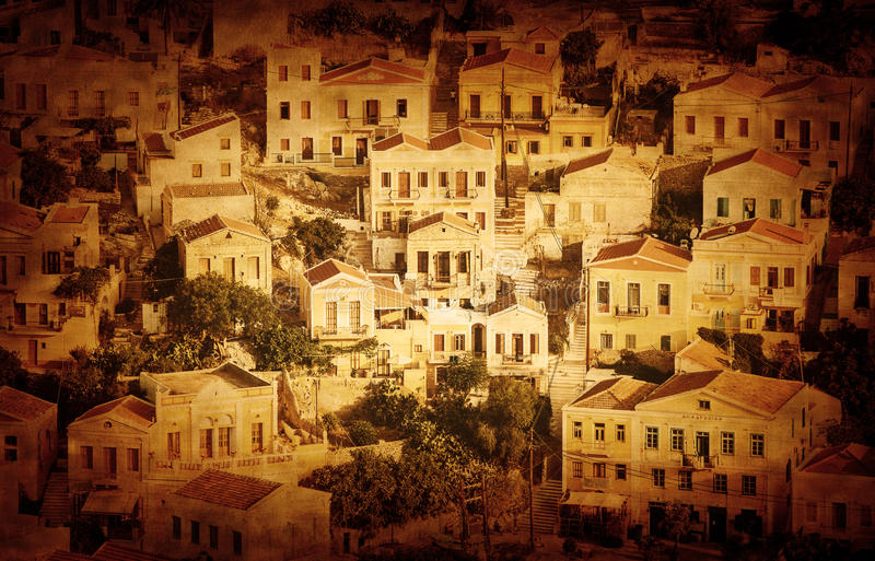 Beautiful cityscape. Grunge photo of beautiful cityscape, many little houses, old European city, retro style image, sepia effect, post card, panorama of Greek royalty free stock images