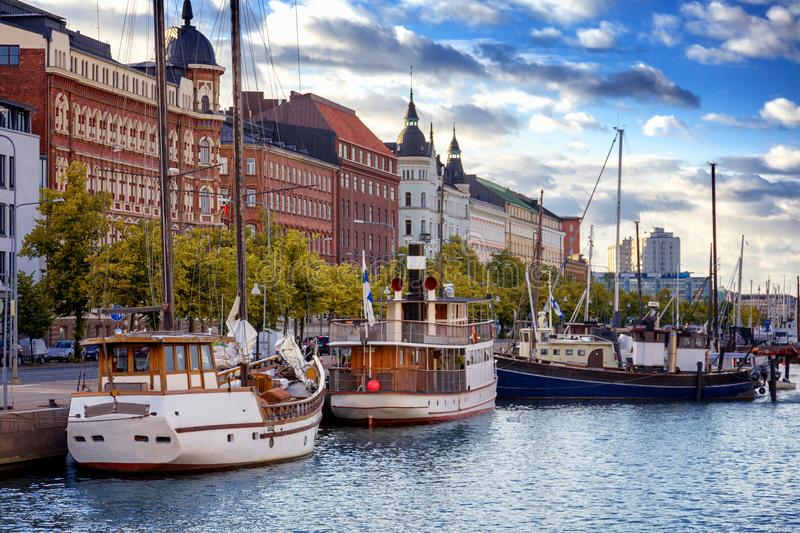 Beautiful cityscape, Helsinki, the capital of Finland, view of t. He embankment with boats and houses at sunset, travel to Northern Europe stock photography