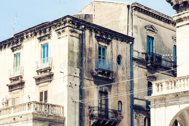 Beautiful cityscape of Italy, facade of ancient house in sicilian baroque style on historical street of Catania, Sicily.  royalty free stock image