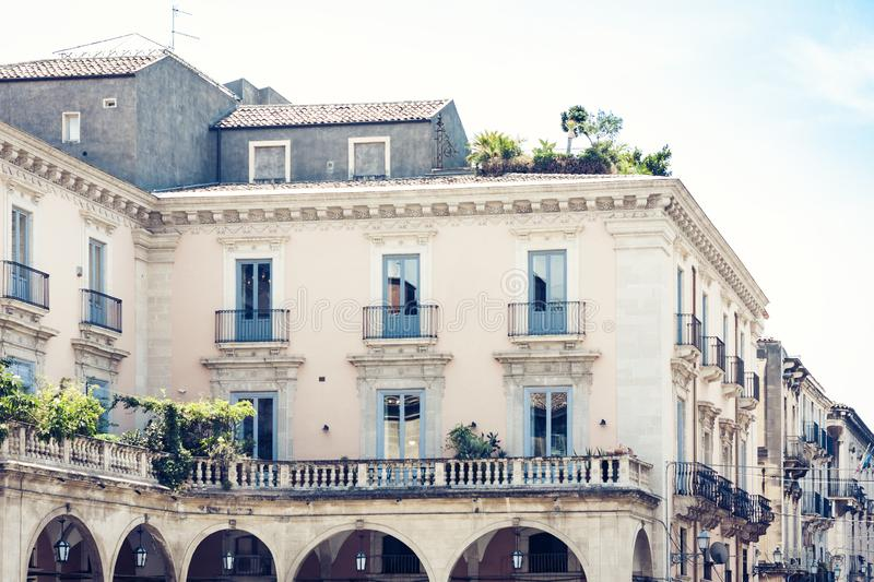 Beautiful cityscape of Italy, facade of ancient house in sicilian baroque style on historical street of Catania, Sicily.  royalty free stock photos