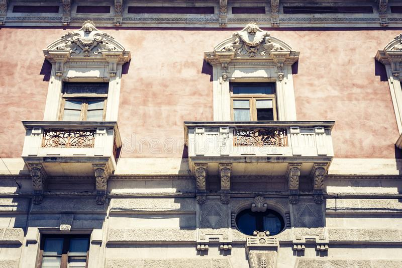 Beautiful cityscape of Italy, facade of ancient house in sicilian baroque style on historical street of Catania, Sicily.  royalty free stock photography