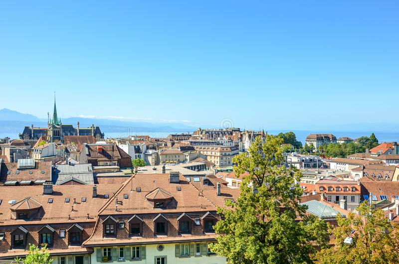 Beautiful cityscape of Lausanne, Switzerland photographed from view point above the city. Geneva Lake and mountains in the royalty free stock photos