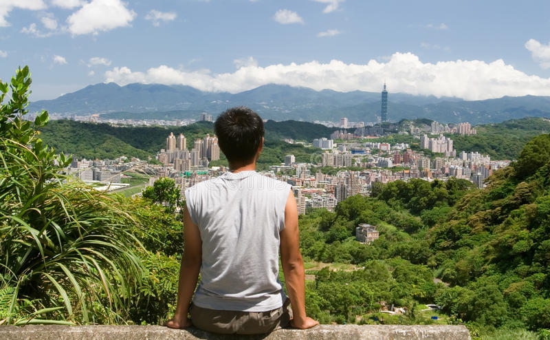Beautiful cityscape with a man sit and watch far a. It is a beautiful cityscape in Asia of Taipei stock photo