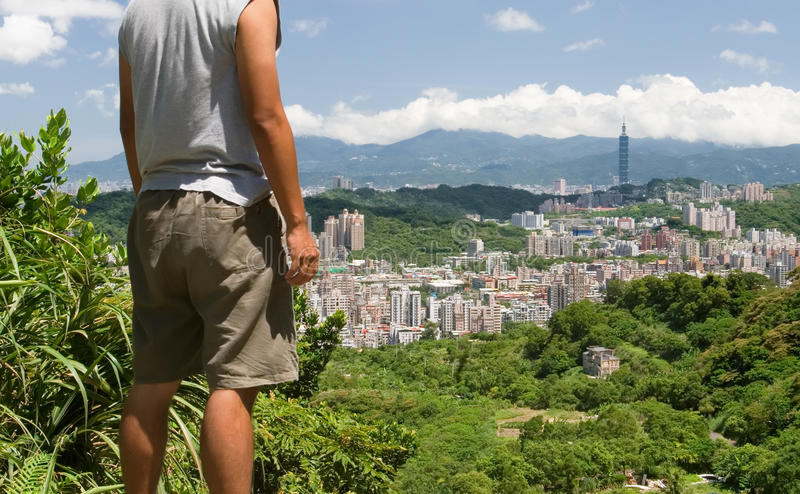 Beautiful cityscape with a man stand and watch far. It is a beautiful cityscape in Asia of Taipei royalty free stock images