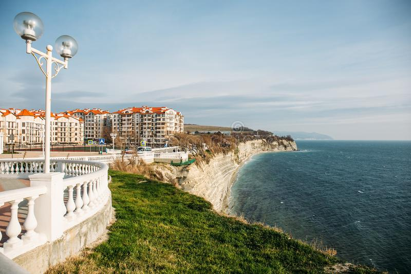 Beautiful cityscape with modern buildings on cliff coastline, blue sea and rocks, Gelendzhik, Russia stock photos