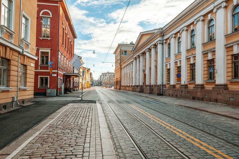 Beautiful cityscape, street in the center of Helsinki, the capital of Finland. Street with paving stones and tram ways. Popular d. Estination for traveling in stock photo