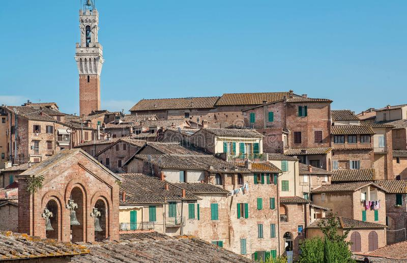 Beautiful cityscape with towers and old homes of Siena, Tuscany. Tile roofs of Italy. UNESCO World Heritage Site royalty free stock photography