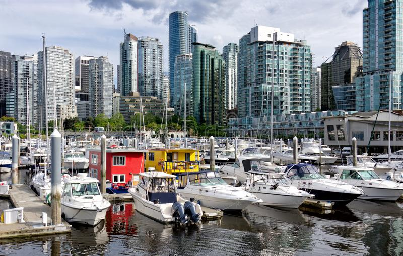 Beautiful cityscape of Vancouver and bright floating houses in marina, British Columbia Canada stock photography
