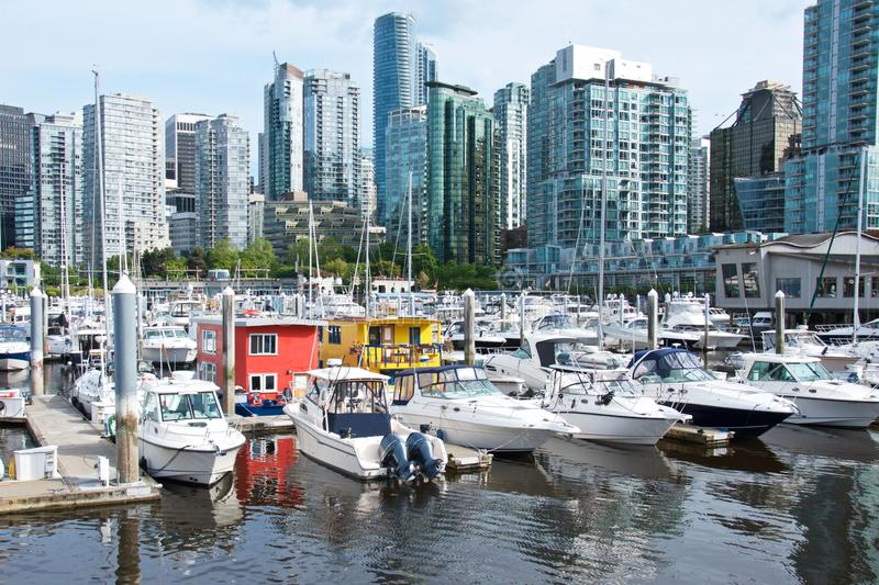 Beautiful cityscape of Vancouver city and bright floating houses in marina stock image