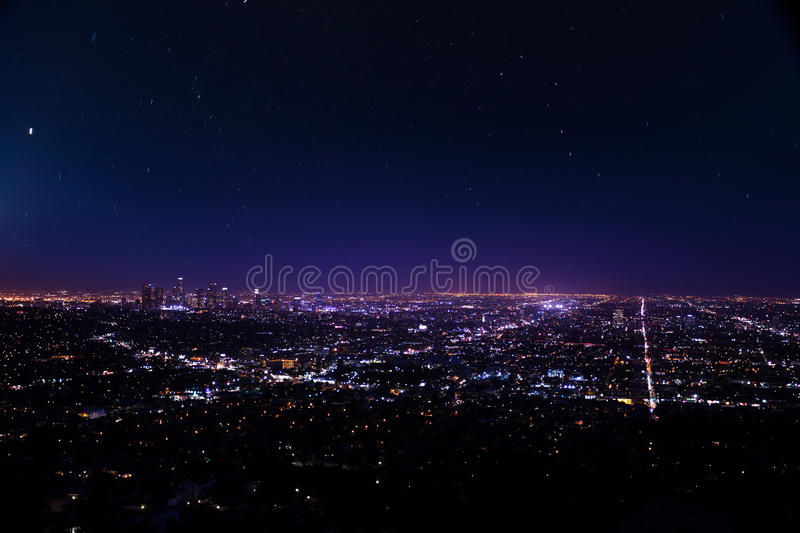 Beautiful cityscape view of Los Angeles at night. From Griffith Observatory with lights and shine of stars in the USA royalty free stock photos