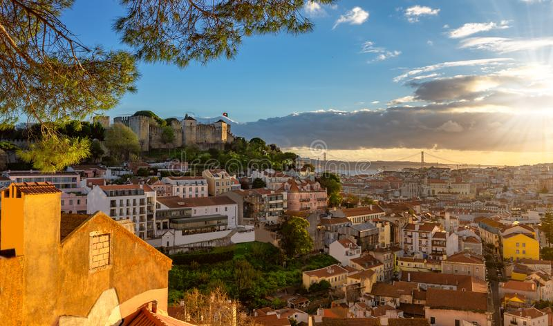 Historic Sao Jorge castle at sunset in Lisbon stock photos