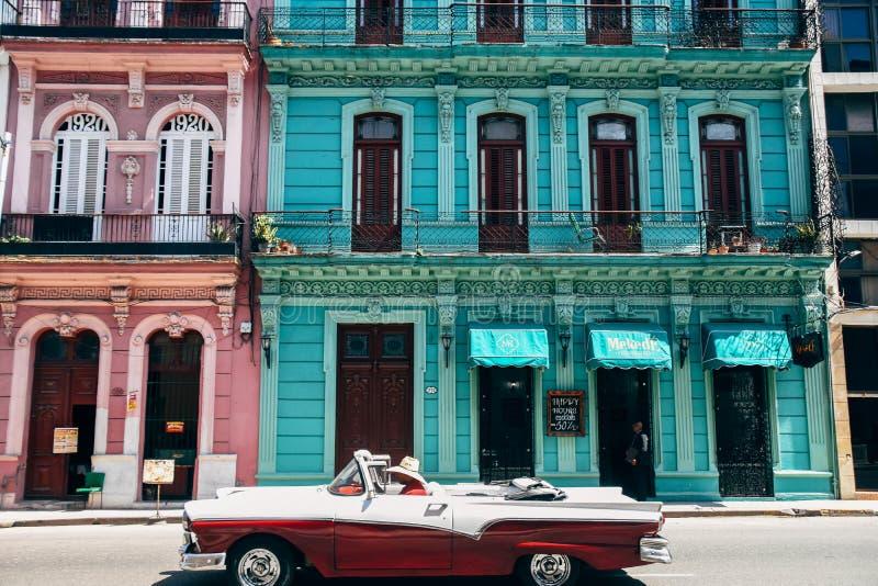 A beautiful classic car in Havana, Cuba. A beautiful classic convertible car drives by in Havana, Cuba stock images
