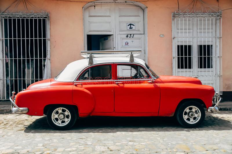 A beautiful classic car in Trinidad, Cuba. A beautiful orange classic car with roof rack parked in Trinidad, Cuba royalty free stock image
