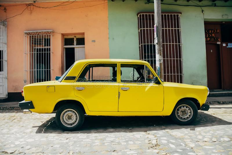 A beautiful classic Lada in Trinidad, Cuba. A beautiful classic yellow Lada in Trinidad, Cuba royalty free stock photography