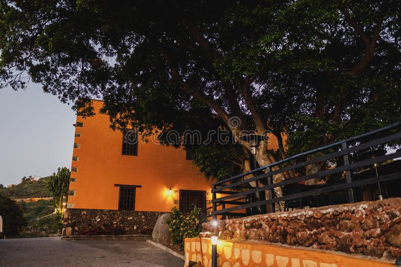 A beautiful, classical rural guest house in heart of Gran Canaria, Spain with an old tree in its front yard stock photography