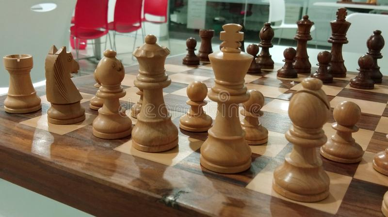 The traditional chess piece on chess board ready for battle. stock photo