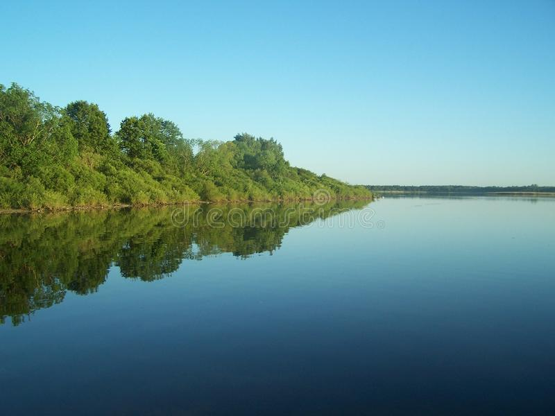 Beautiful clean lake and blue sky. royalty free stock photos