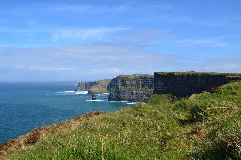 Beautiful clear blue skies by the Cliffs of Moher royalty free stock photo