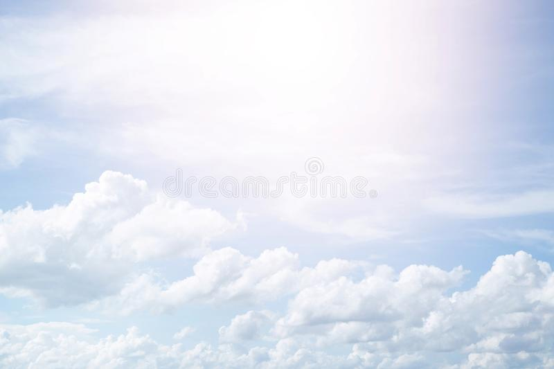Beautiful clear blue sky background with  plain  large white cloud on morning time rays sunlight. stock photos