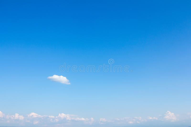 Beautiful clear blue sky with clouds patches stock photo