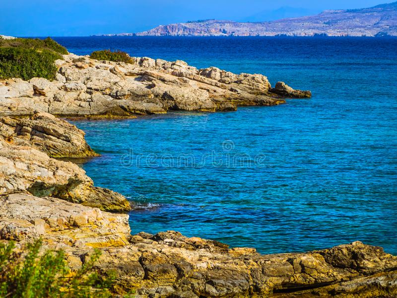 Beautiful clear blue water and rocky hidden beach stock image