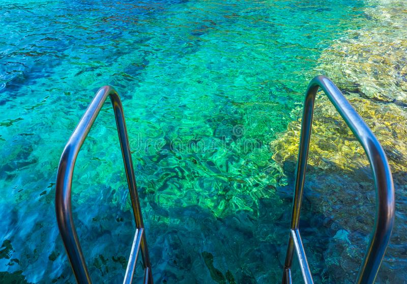 Beautiful clear blue waters of Aegean Sea - edge of the rail steps on the ship royalty free stock images