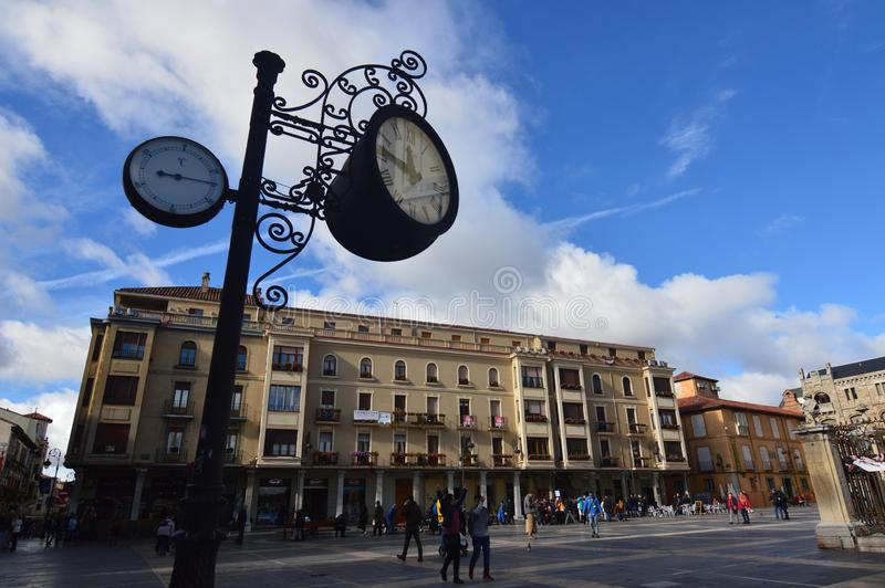 Beautiful Clock And Analog Thermometer With Beautiful Buildings Behind The Cathedral Square In Leon. Architecture, Travel, History royalty free stock photo