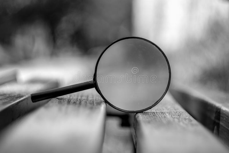 Beautiful close up on a magnifying glass stock image