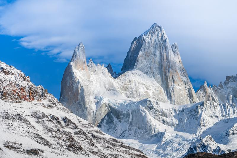 Beautiful close up view of Fitz roy mountains with white snow peak in sunny blue sky day in autumn, El Chalten, south Patagonia, royalty free stock photography