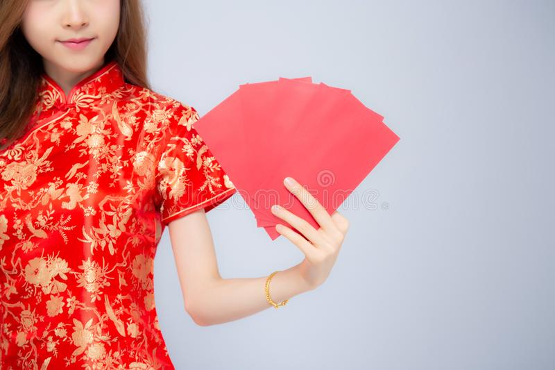Beautiful closeup asian woman cheongsam dress holding red envelope on white background. Girl celebrate with exciting, happy Chinese New Year, holiday concept royalty free stock photo