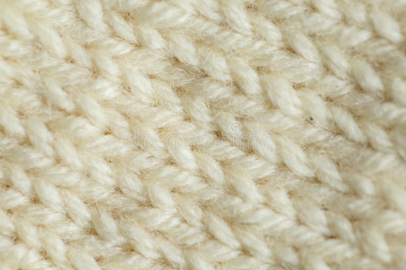 A beautiful closeup of a hand knitted warm and soft wool pattern. Soft socks or scarf of natural wool. Colorful pattern royalty free stock photography
