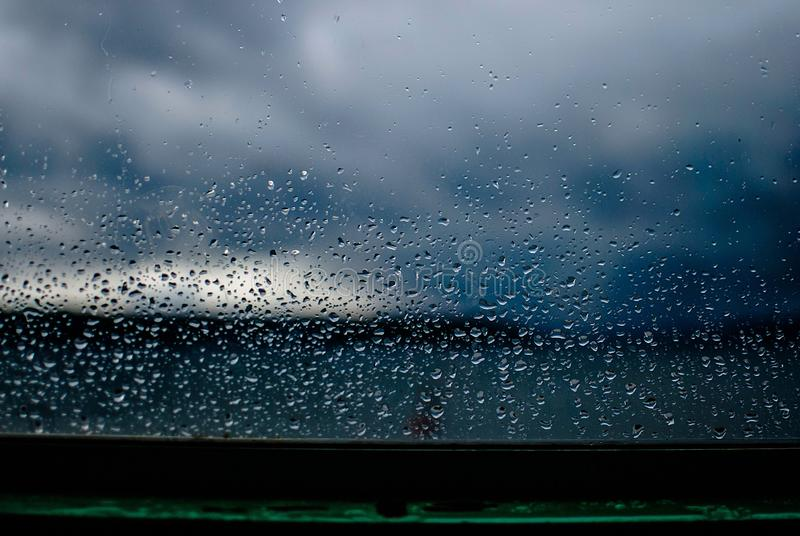 Beautiful closeup shot of the rain drops on a window captured in Seattle, USA. A beautiful closeup shot of the rain drops on a window captured in Seattle, USA royalty free stock images