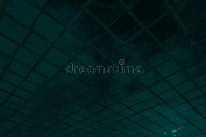 Beautiful closeup textures abstract color dark black and blue tiles granite and blue glass pattern wall and background and art royalty free stock photo