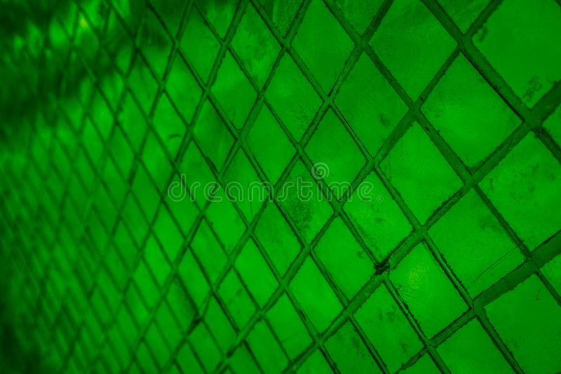 Beautiful closeup textures abstract color dark black and green tiles granite and blue glass pattern wall and background and art royalty free stock photography