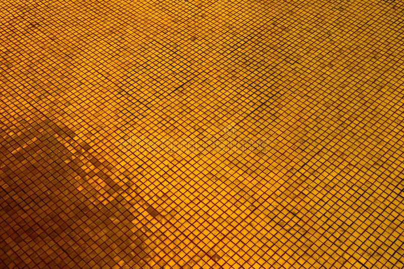 Beautiful closeup textures abstract tiles and black gold and yellow color glass pattern wall background and art wallpaper. S royalty free stock image