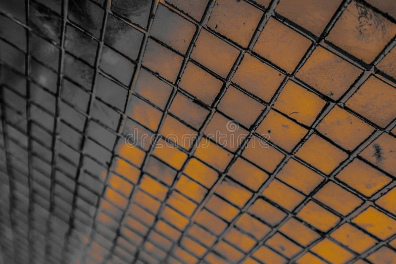 Beautiful closeup textures abstract tiles and black gold and yellow color glass pattern wall background and art wallpaper. S stock image