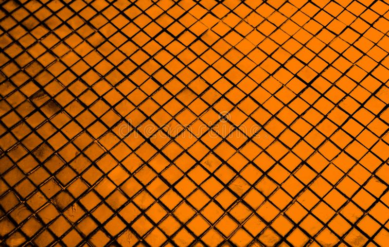 Beautiful closeup textures abstract tiles and black gold and yellow color glass pattern wall background and art wallpaper. S royalty free stock photography